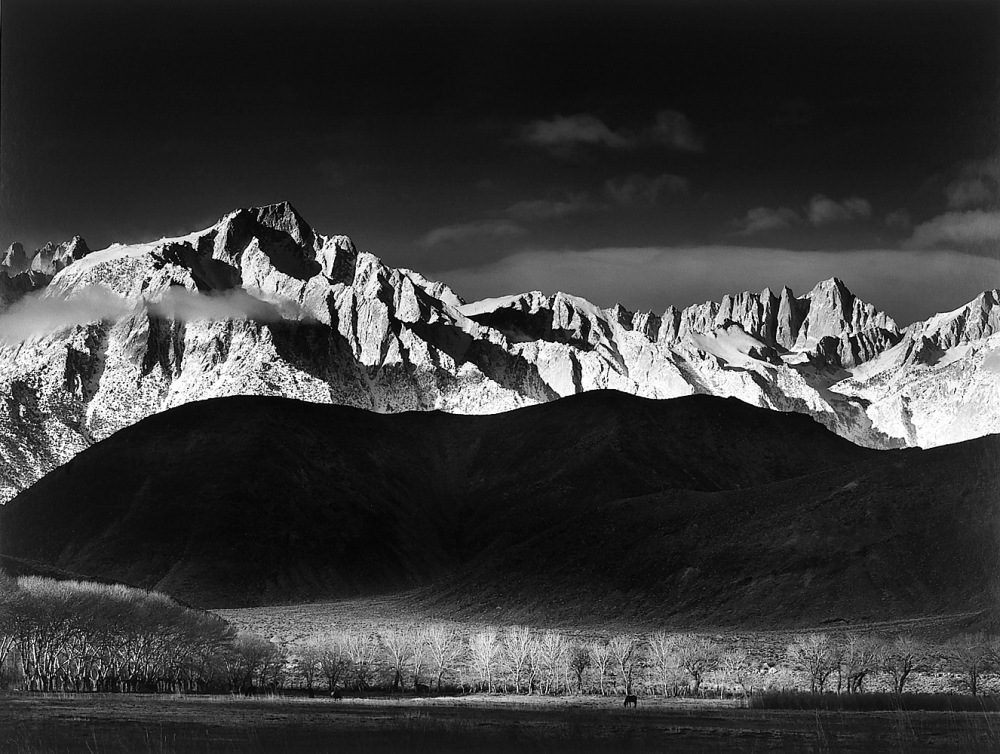 ANSEL ADAMS  Winter Sunrise, Sierra Nevada from Lone Pine, California (1944)  Gelatin silver print.